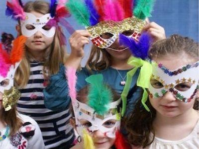 Kids wearing venitian face masks