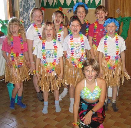Kids dressed in luau costumes